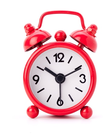 Little red alarm clock on a white background photo