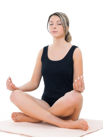 Blonde girl practicing yoga on isolated white background Stock Photo - 12054186