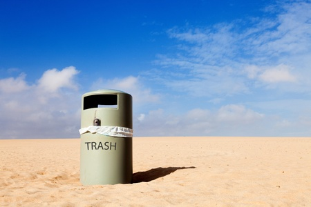 Trash can in desert nature landscape photo