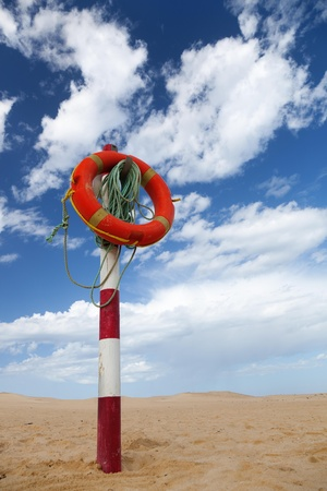 Life buoy on a beach photo