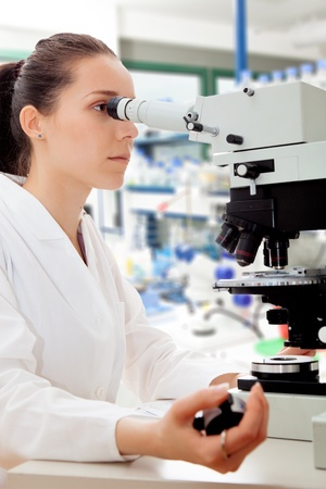 girl - scientist counts the number of bulleted cells Stock Photo - 12285500