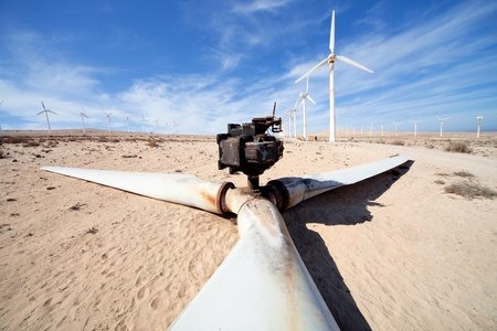Crashed wind turbine  in the desert landscape photo
