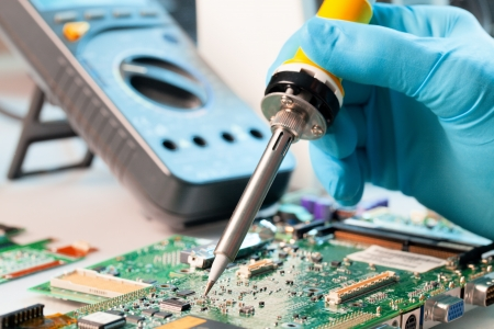 pcb: Repaired by soldering a PC board Stock Photo