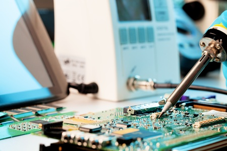 Repaired by soldering a PC board Stock Photo
