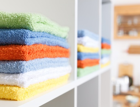 Stack of towels in the linen closet Stock Photo