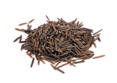 wild rice: Seeds of wild rice on white background