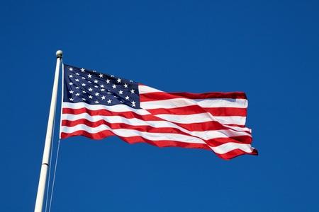 american flag waving: American flag against blue sky
