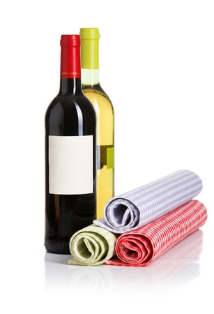 Bottle of red and white wines from the napkins on white background photo