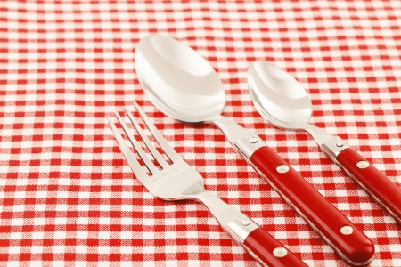 Spoon, fork and knife table setting photo