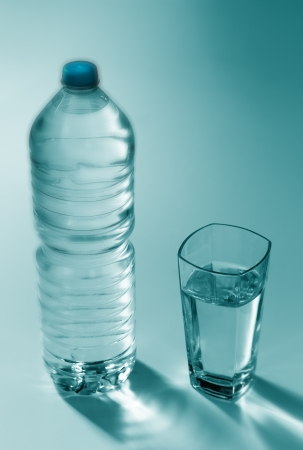 food testing: Plastic bottle with water and a glass of drink