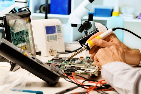 Repair of printed circuit boards in the radio laboratory Stock Photo - 14493929