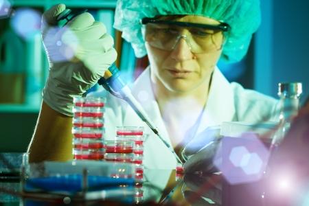 eppendorf: Scientist pipetting a liquid into Eppendorf tubes.