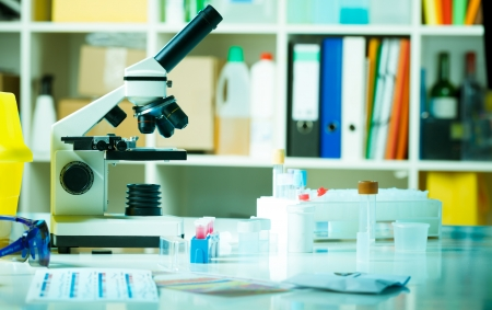 food testing: Table with a microscope preparations an biochemical laboratory Stock Photo