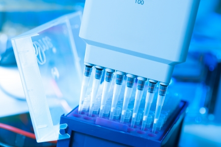 sample tray: Sampling multipipette in  biochemical laboratory