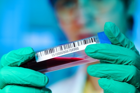 Sample in test tube with bar code photo