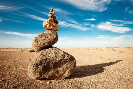 cairn: Rock cairn in the desert