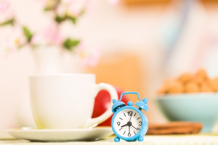 coffeecup: Cup of coffee and a small clock