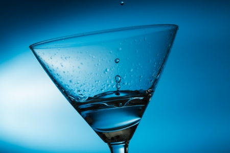 martini glass: Drink drips into Martini glass