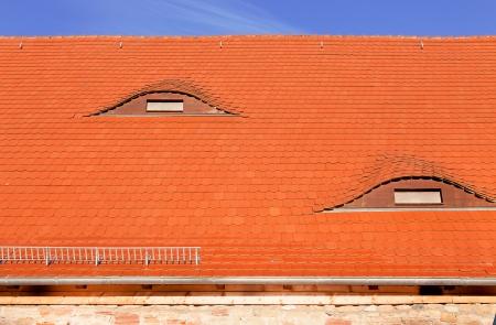 Dormer window on the tile roof photo