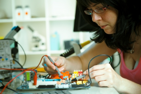 microchip: Girl debugging an electronic precision device