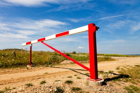 Red gate on a country road Stock Photo - 17894782
