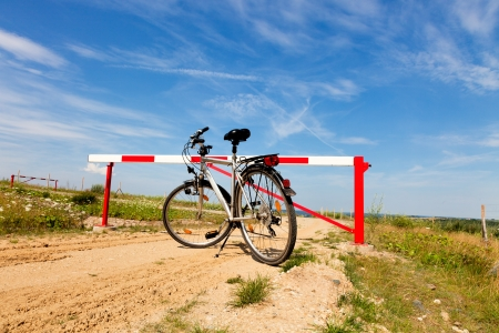 sequestration: Red gate on a country road