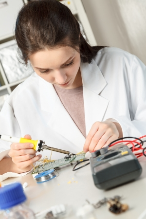 Girl student in the laboratory of electronics university photo