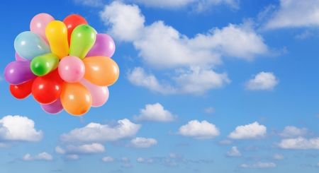 Color Balloons flying in the Blue sky photo