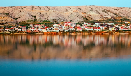 Reflection of buildings in the mirror Tranquil sea Pag Croatia, Adriatic Mediterranean Sea, nature Dalmatia