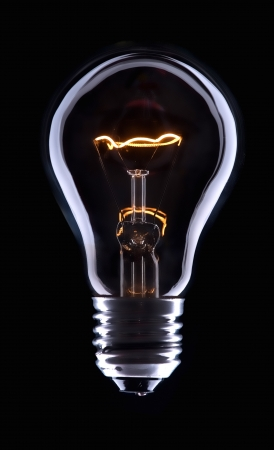 electric bulb: Electric bulb lamp with a spiral on a black background