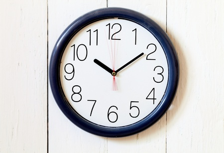second meal: Clock on a wooden wall Stock Photo