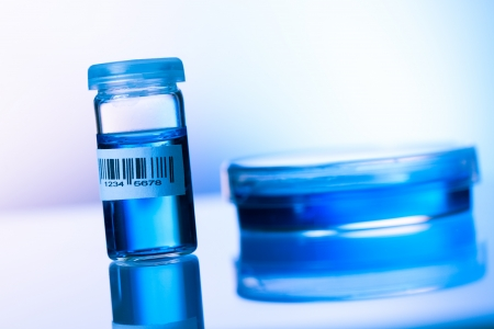 drug test: bottle barcode and petri dishes Stock Photo