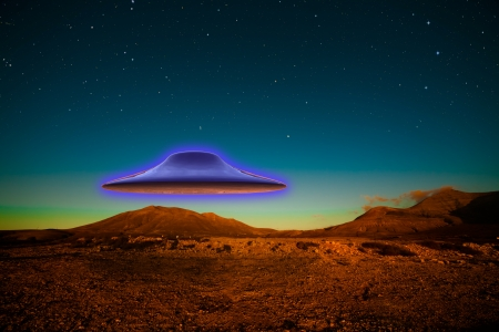 invasion: Flying UFO in desert at night