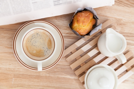 cake muffin with coffee on wooden table photo