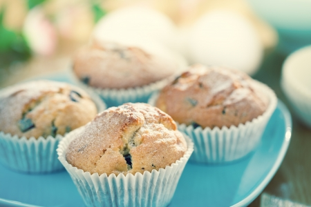 white backing: Delicious decorated muffins on table