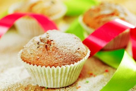 Delicious decorated muffins on table photo
