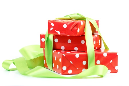 Red gift  boxs tied with a green satin ribbon bow Isolated on white background photo