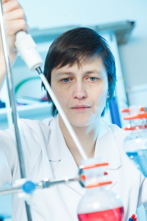 food testing: woman laboratory assistant in the laboratory of food quality Stock Photo