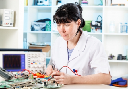 solder: woman solder microchip Stock Photo