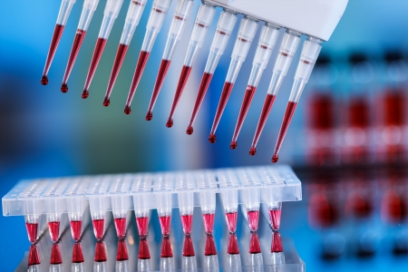 multipipette and sample tray biotech concept Stock Photo