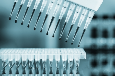 sequencing: multipipette and sample tray biotech concept Stock Photo