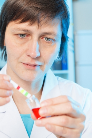 food research: woman laboratory assistant in the laboratory of food quality Stock Photo