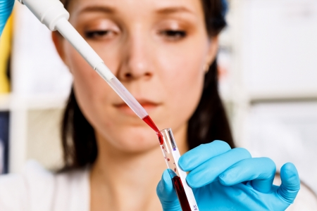 girl takes a sample of biological material Stock Photo - 21143076