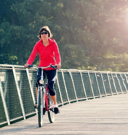 woman rides a bicycle around the city park