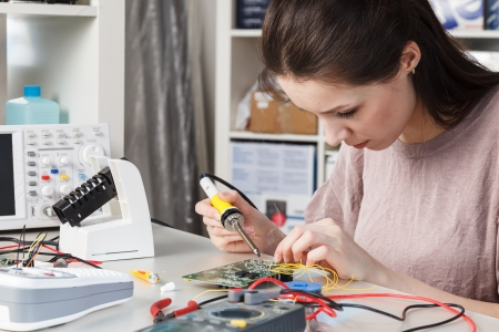 microelectronics: Girl in radio electronics lab