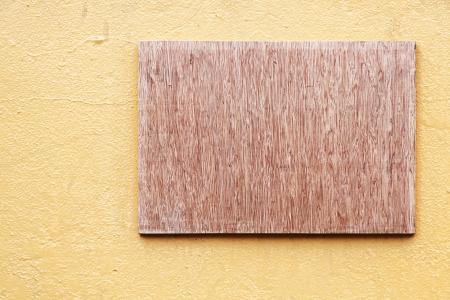 Empty Wooden board on stone wall photo