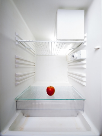 apple in an empty refrigerator photo