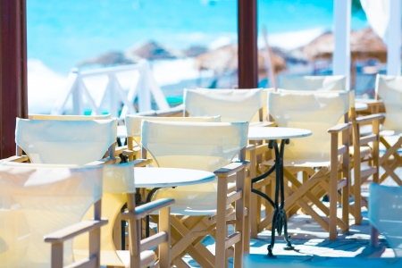 beach bar: restaurant on the beach with empty tables Stock Photo