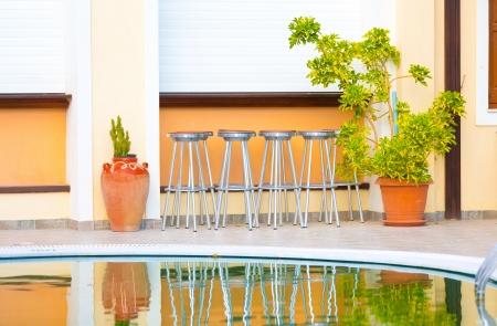 pool bar: bar chairs and a swimming pool