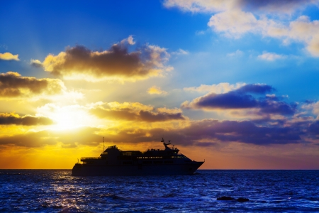 oceanic: oceanic cruise ship at sunset Stock Photo